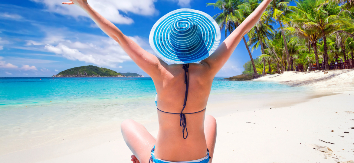 53176188 - woman in hat enjoying sun holidays on the tropical beach